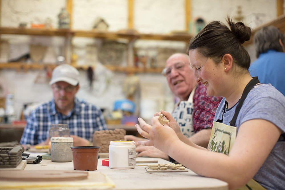 service users working with clay