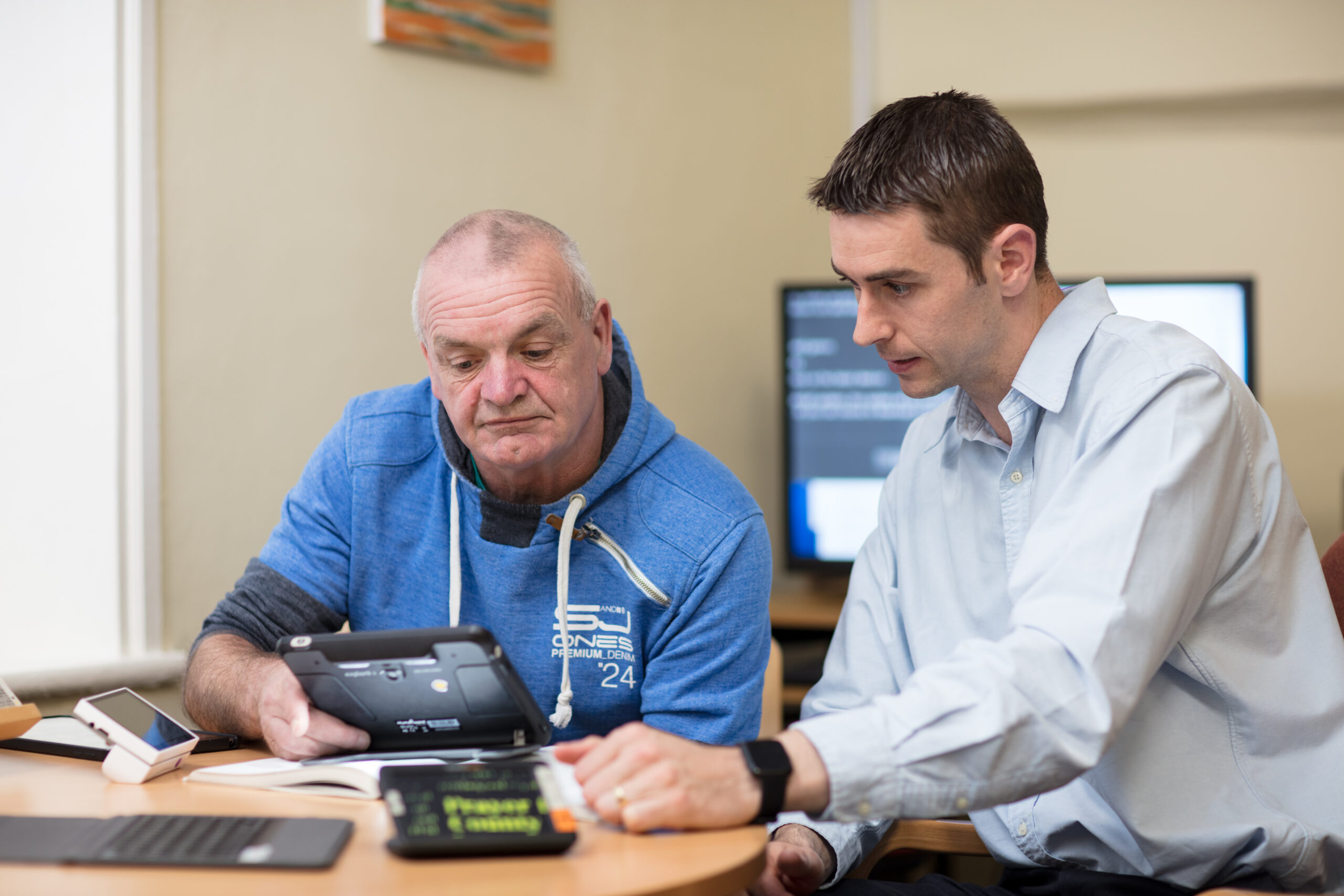 Image of service user trialing magnification aids