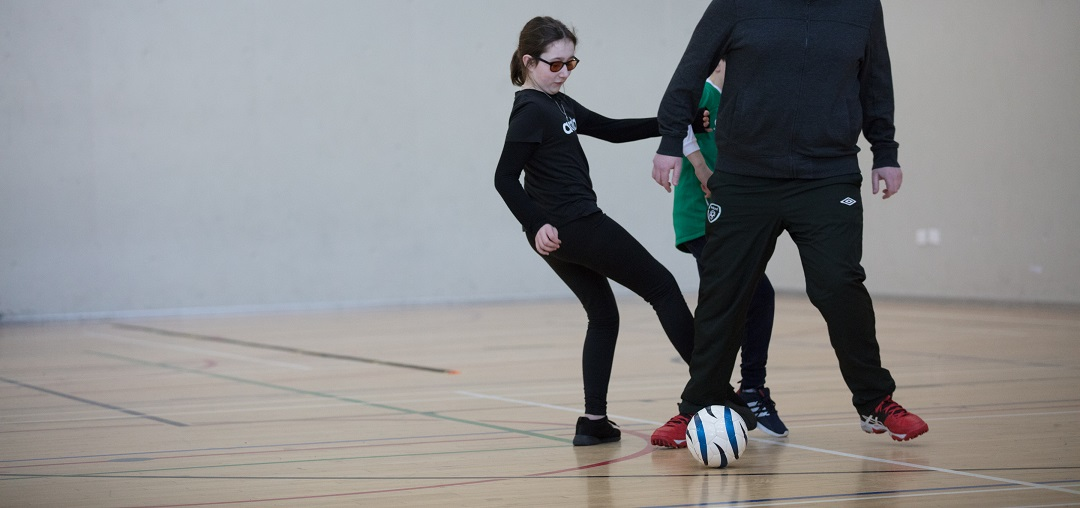 Image of Annie playing blind football