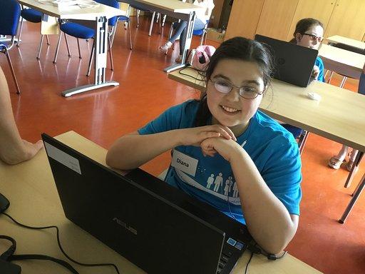 teenage girl at a laptop