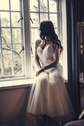 bride looking at the window