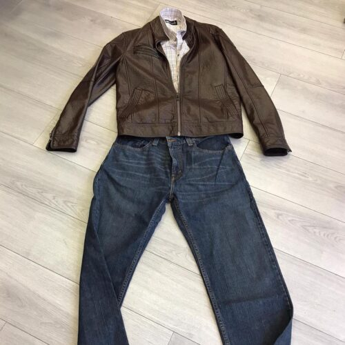 NCBI man outfit: denin trousers and brown letter jacket